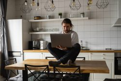 Entrepreneur working at home in his kitchen